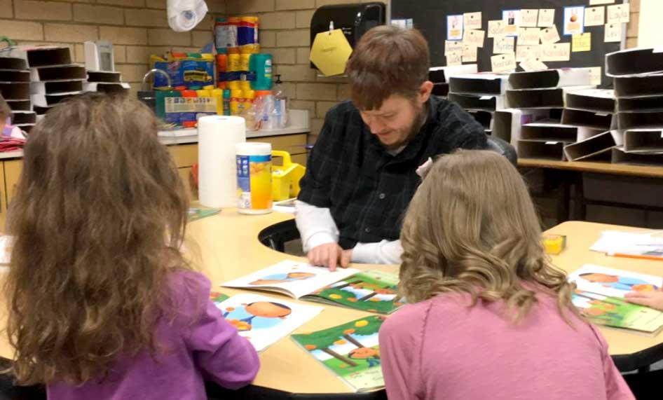 Man reading to kids