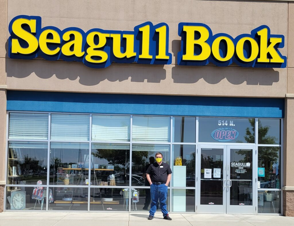 Person standing outside bookstore